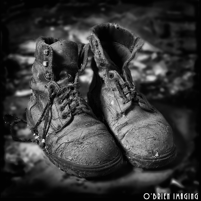Old boots photographed on an old constrution site