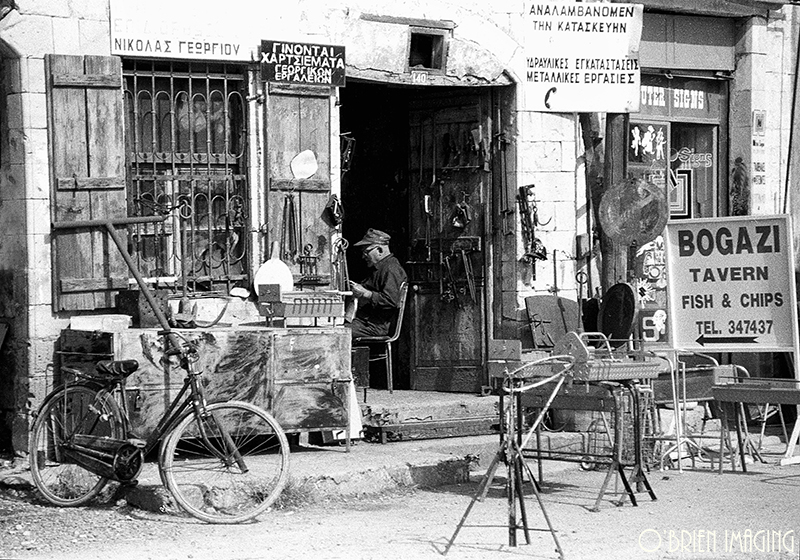 Shopkeeper sitting in his store (Cyprus)